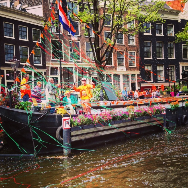 Kings day on the canals in Amsterdam
