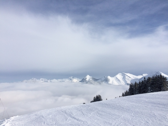 Clouds above the mountains in the French Alps